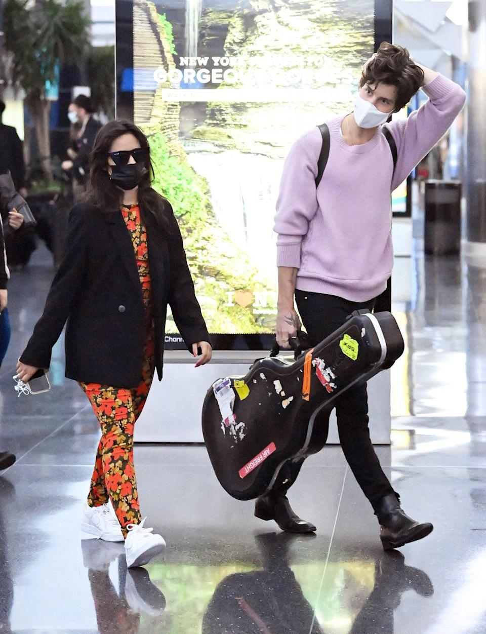 <p>Camila Cabello and Shawn Mendes arrive at JFK International Airport in N.Y.C. on July 20.</p>