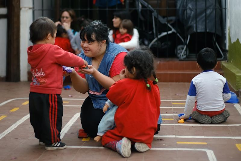 Noelia Garella (C) is the first person with Down syndrome to work as a preschool teacher in Argentina -- and one of the few in the world (AFP Photo/Diego Lima)