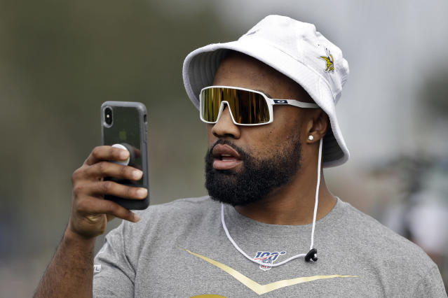 NFC defensive end Everson Griffen, of the Minnesota Vikings, live streams during a practice for the NFL Pro Bowl football game Thursday, Jan. 23, 2020, in Kissimmee, Fla. (AP Photo/Chris O'Meara)