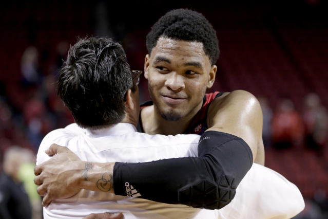 Nebraska's James Palmer Jr., right, hugs coach Tim Miles following an NCAA college basketball game against Minnesota in Lincoln, Neb., Wednesday, Feb. 13, 2019. Palmer made two free throws with 1.1 seconds left to give Nebraska a 62-61 win over Minnesota, ending the Cornhuskers seven-game losing streak. (AP Photo/Nati Harnik)