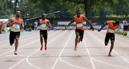 Tyson Gay of the USA (L) wins the Men's 100 meters heat B