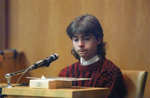 PHOTO: William Flynn, 17, looks at state police photo of Gregory Smart, during his testimony in Exeter, N.H., March 12, 1991. (Jim Cole/AP, FILE)