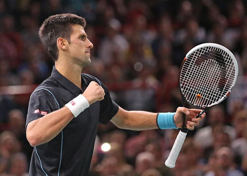Serbia's Novak Djokovic jubilates after winning a point during his final match against Spain's David Ferrer, at the Paris Masters tennis, in the Paris Bercy stadium, Sunday Nov. 3, 2013.(AP Photo/Remy de la Mauviniere)
