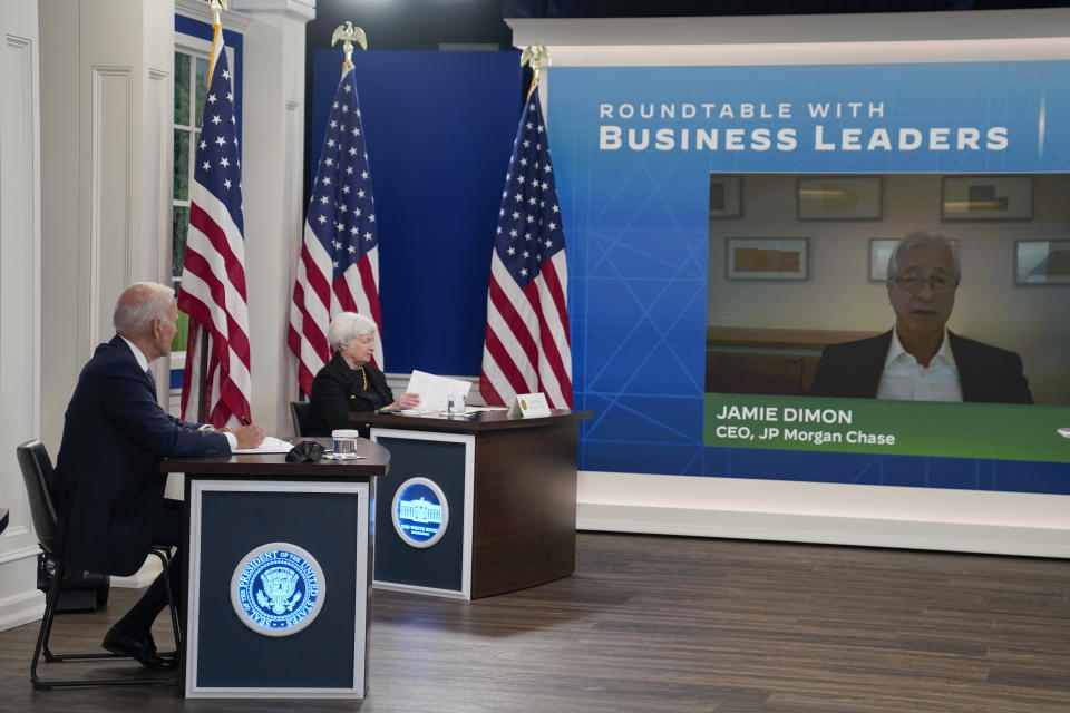 President Joe Biden and Treasury Secretary Janet Yellen listen as Jamie Dimon, CEO of JP Morgan Chase, speaks during a meeting with business leaders about the debt limit in the South Court Auditorium on the White House campus, Wednesday, Oct. 6, 2021, in Washington. (AP Photo/Evan Vucci)