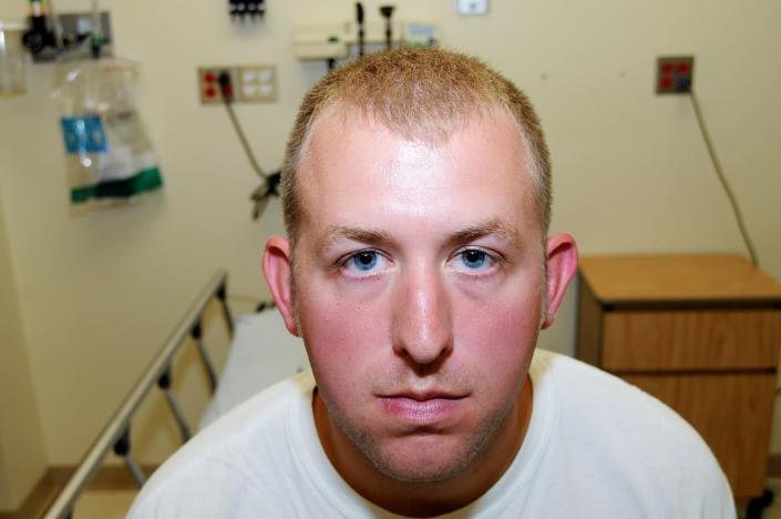 FILE - In this 2014 file photo provided by the St. Louis County Prosecuting Attorney's Office is Ferguson police officer Darren Wilson during his medical examination after he the fatal shooting of Michael Brown. St. Louis County's top prosecutor announced Thursday, July 30, 3030, that he will not charge Brown, the former police officer who fatally shot Michael Brown in Ferguson, Mo. (St. Louis County Prosecuting Attorney's Office via AP, File)