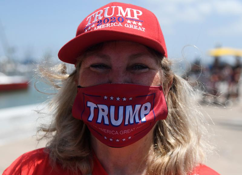 Mary Delany wears a Trump hat and mask at a gathering, Saturday, July 11, 2020, at the Selena Memorial statue. Delany came with her husband and two dogs.