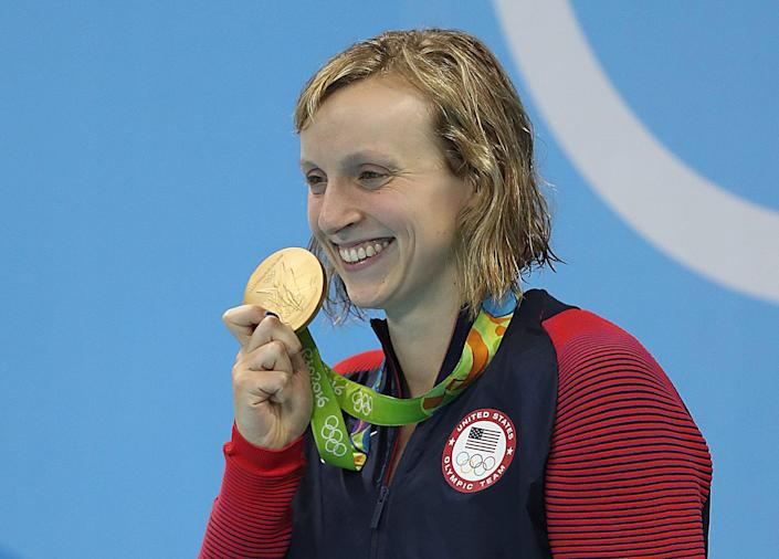 RIO DE JANEIRO, BRAZIL - AUGUST 12: A tearful Katie Ledecky of United States is seen on the podium during her National anthem after the Women's 800m Freestyle final and winning gold on Day 7 of the Rio 2016 Olympic Games at the Olympic Aquatics Stadium on August 12, 2016 in Rio de Janeiro, Brazil. (Photo by Ian MacNicol/Getty Images)