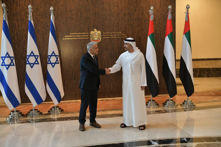 In this photo made available by the Israeli Government Press Office, Israeli Foreign Minister Yair Lapid shakes hands with United Arab Emirates Foreign Minister Sheikh Abdullah bin Zayed al-Nahyan in Abu Dhabi, United Arab Emirates, Tuesday, June 29, 2021. Lapid kicked off the highest-level visit by an Israeli official to the UAE on Tuesday, nine months after the two established relations in a deal brokered by the United States. (Shlomi Amsalem/Government Press Office via AP)
