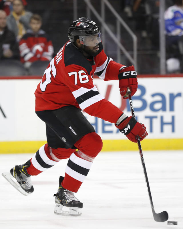 New Jersey Devils defenseman P.K. Subban (76) takes the puck upice during the first period of an NHL hockey game against the Detroit Red Wings, Thursday, Feb. 13, 2020, in Newark, N.J. (AP Photo/Kathy Willens)