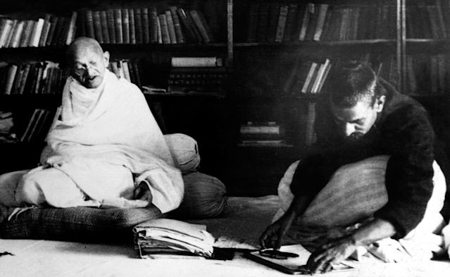 Picture dated 03 February 1940 of spiritual leader of India Mohandas Karamchand Gandhi (L), known as the Mahatma Gandhi (1869-1948), working with the president of the Work Congress in Allahabad. Founder of the Indian National Congress, he led the struggle for India's independence from British colonial rule. He was the pioneer of the resistance through mass civil disobedience, firmly founded upon total non-violence, which was one of the strongest driving philosophies of the Indian independence movement and inspired movements for civil rights and freedom across the world. He was assassinated by a Hindu fanatic. (Photo credit should read OFF/AFP via Getty Images)