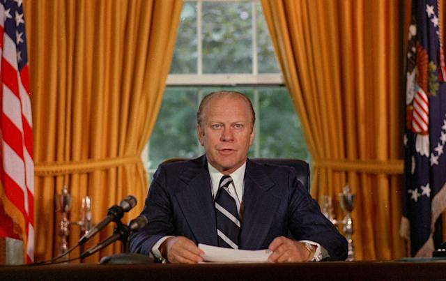 """<p>President Gerald Ford reads a proclamation in the White House on Sept. 8, 1974, granting former president Richard Nixon """"a full, free and absolute pardon"""" for all """"offenses against the United States"""" during the period of his presidency. (Photo: AP) </p>"""