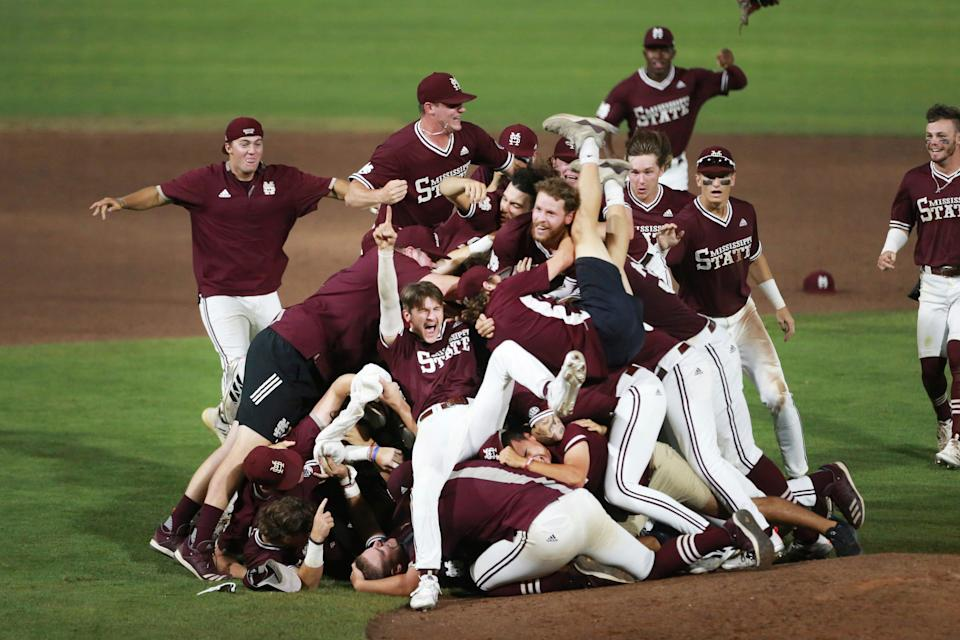 The Mississippi State Baseball team celebrates after defeating Notre Dame in an NCAA college baseball super regional game, Monday, June 14, 2021, in Starkville, Miss. (Adam Robison/The Northeast Mississippi Daily Journal via AP)