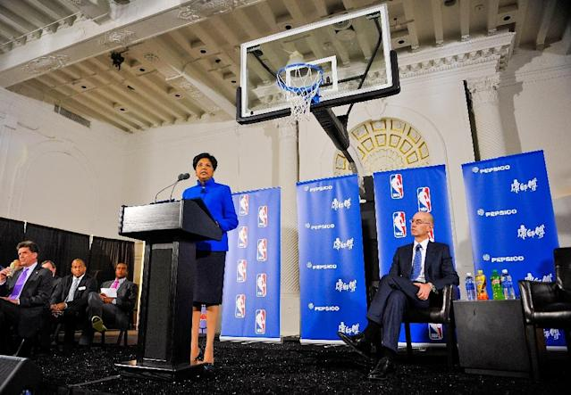 PepsiCo CEO Indra Nooyi (L) speaks as NBA Commissioner Adam Silver looks on during a press conference on April 13, 2015 in New York (AFP Photo/Alex Goodlett)
