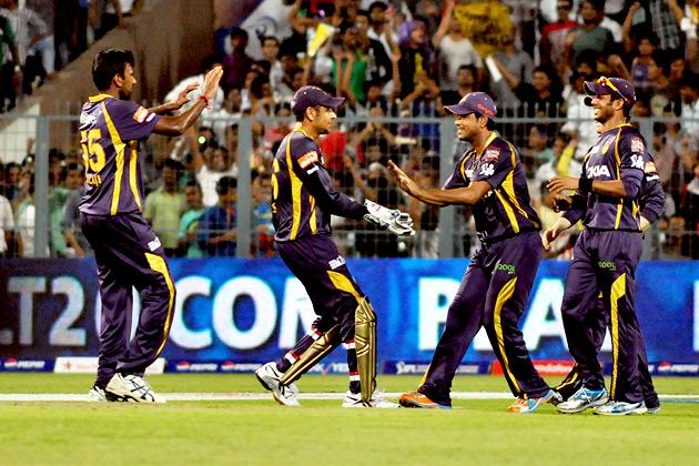 KKR players celebrate the fall of wicket during the match