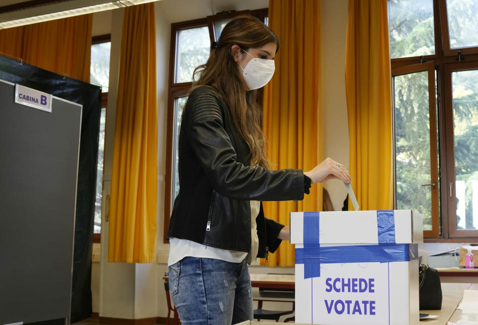 A woman casts her ballot for the abortion referendum at a polling station in San Marino, Sunday, Sept. 26, 2021. Tiny San Marino is one of the last countries in Europe which forbids abortion in any circumstance — a ban that dates from 1865. Its citizens are voting Sunday in a referendum calling for abortion to be made legal in the first 12 weeks of pregnancy. (AP Photo/Antonio Calanni)