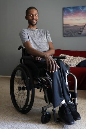 T'angelo Magee poses in his wheel chair in Hackensack, New Jersey