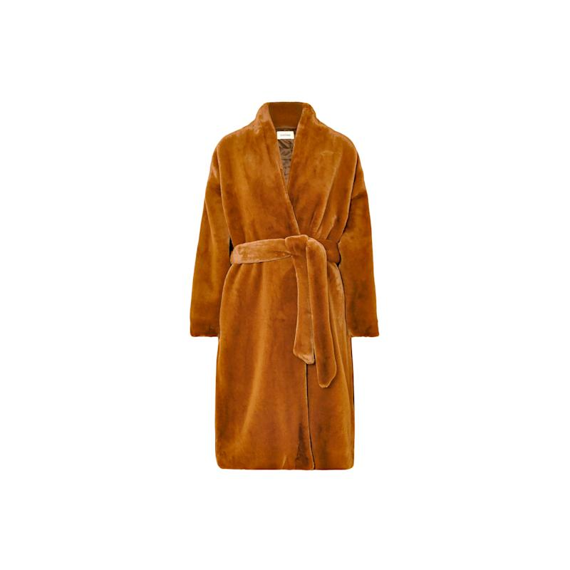 Perhaps one of the most popular faux fur coats of this winter, and for good reason. This Totême full-length coat is one you'll cherish for the ages. Buy now: Toteme coat, $900, netaporter.com.