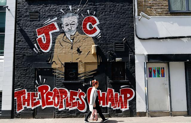 <p>A woman walks past a Jeremy Corbyn mural in Camden, London on Thursday, June 1, 2017. (Photo: Frank Augstein/AP) </p>