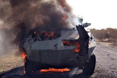 Boko Haram fighters' armoured vehicle burns after being set ablaze by the Nigerian military at Monguno on February 15, 2015 (AFP Photo/)