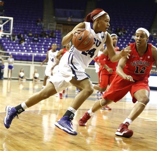 TCU guard Natalie Ventress (24) drives to the basket as Georgia forward Jasmine Hassell (12) defends in the first half of an NCAA women's college basketball game on Wednesday, Dec. 19, 2012, in Fort Worth, Texas. (AP Photo/Sharon Ellman)
