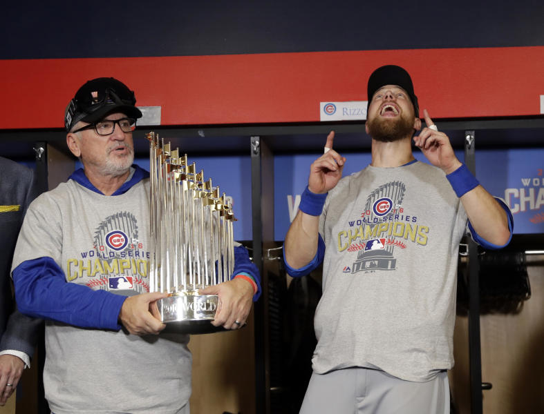 FILE - In this Nov. 3, 2016, file photo, Chicago Cubs manager Joe Maddon, left, and Ben Zobrist celebrate after Game 7 of the Major League Baseball World Series against the Cleveland Indians, in Cleveland. Maddon has agreed to become the Los Angeles Angels' manager. Maddon and the Angels agreed to terms Wednesday, Oct. 16, 2019,  on a deal to reunite the veteran manager with the organization where he spent the first three decades of his baseball career. (AP Photo/David J. Phillip, File)