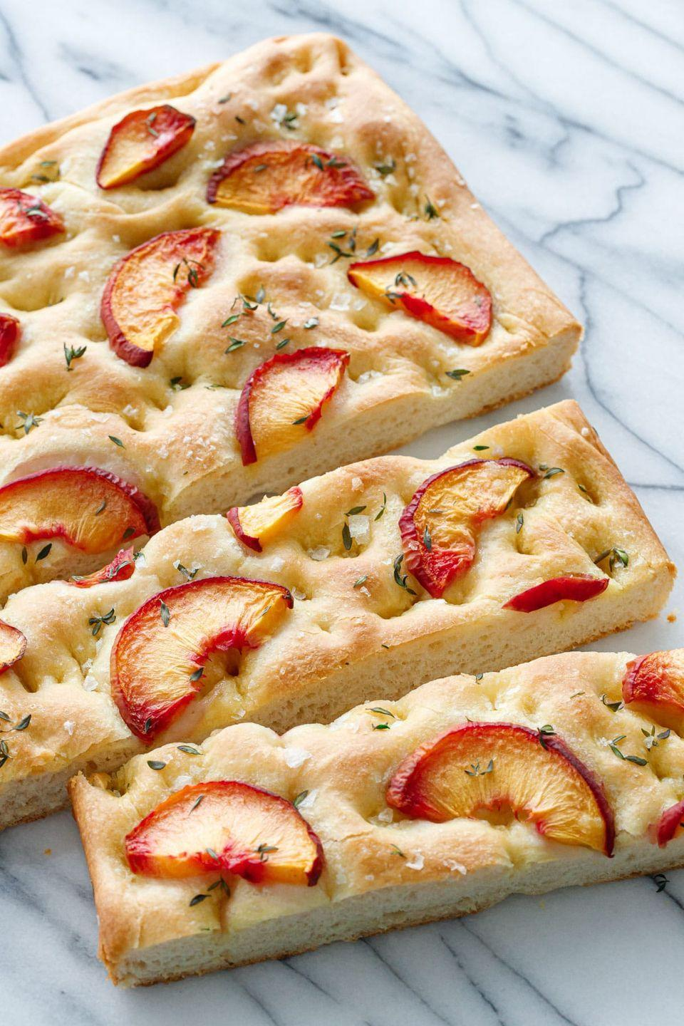 """<p>This bread, topped with thin slices of peaches, a sprinkling of herbs, and chunky sea salt, looks like something you'd find at a five-star restaurant, but is surprisingly easy to make. </p><p><a href=""""https://www.loveandoliveoil.com/2019/08/peach-focaccia-bread.html"""" rel=""""nofollow noopener"""" target=""""_blank"""" data-ylk=""""slk:Get the recipe."""" class=""""link rapid-noclick-resp"""">Get the recipe. </a></p>"""