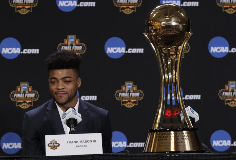 Kansas' Frank Mason III stands answers questions with his Associated Press Player of the Year trophy at a news conference Thursday, March 30, 2017, in Glendale, Ariz. (AP Photo/Matt York)