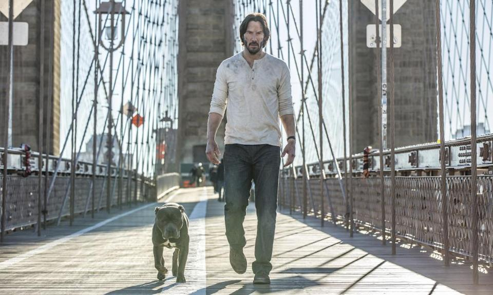 Excommunicado: Winston and John Wick (Keanu Reeves).
