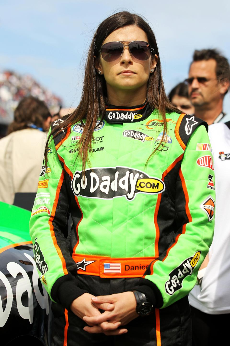 DAYTONA BEACH, FL - FEBRUARY 25: Danica Patrick, driver of the #7 GoDaddy.com Chevrolet, stands on the grid prior to the start of the NASCAR Nationwide Series DRIVE4COPD 300 at Daytona International Speedway on February 25, 2012 in Daytona Beach, Florida. (Photo by Todd Warshaw/Getty Images for NASCAR)