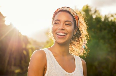 """<span class=""""caption"""">Happiness is complex.</span> <span class=""""attribution""""><a class=""""link rapid-noclick-resp"""" href=""""https://www.shutterstock.com/image-photo/portrait-beautiful-african-american-woman-smiling-1123160147"""" rel=""""nofollow noopener"""" target=""""_blank"""" data-ylk=""""slk:Rido/Shutterstock"""">Rido/Shutterstock</a></span>"""