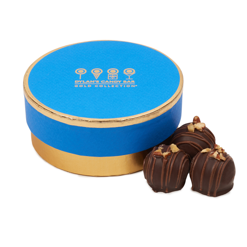 """<p><strong>gold collection</strong></p><p>dylanscandybar.com</p><p><strong>$15.00</strong></p><p><a href=""""https://go.redirectingat.com?id=74968X1596630&url=https%3A%2F%2Fwww.dylanscandybar.com%2Fcollections%2Fgold-collection%2Fproducts%2Fgold-collection-caramel-pecan-chocolate-truffles&sref=https%3A%2F%2Fwww.redbookmag.com%2Ffashion%2Fg34822878%2Fstocking-stuffers-for-her%2F"""" rel=""""nofollow noopener"""" target=""""_blank"""" data-ylk=""""slk:Shop Now"""" class=""""link rapid-noclick-resp"""">Shop Now</a></p><p>No stocking is complete without something sweet. These Gold Collection Caramel Pecan Chocolate Truffles from Dylan's Candy Bar are the perfect delicious and indulgent treat to add to her gifts this Holiday.</p>"""