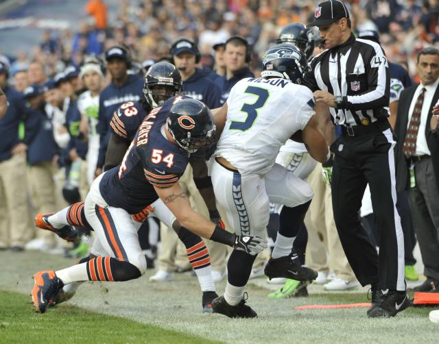 CHICAGO, IL - DECEMBER 02: Russell Wilson #3 of the Seattle Seahawks is pushed out of bounds by Brian Urlacher #54 of the Chicago Bears on December 2, 2012 at Soldier Field in Chicago, Illinois.The Seattle Seahawks defeated the Chicago Bears 23-17 in overtime. (Photo by David Banks/Getty Images)