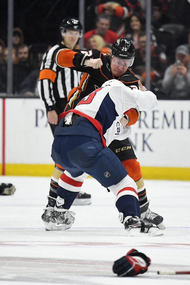 Anaheim Ducks left wing Nicolas Deslauriers, top, fights with Washington Capitals defenseman Radko Gudas during the second period of an NHL hockey game Friday, Dec. 6, 2019, in Anaheim, Calif. (AP Photo/Mark J. Terrill)