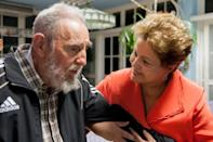 <p>Brazil's President Dilma Rousseff visits with Cuba's former President Fidel Castro in Havana, Cuba, in Havana, Cuba, Monday, Jan. 27, 2014. Rousseff is in Havana to attend the Community of Latin American and Caribbean States summit. (AP Photo/Cubadebate, Alex Castro) </p>