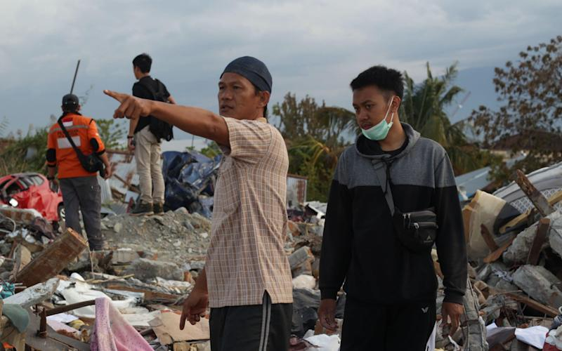 People are frantically searching for survivors - AFP