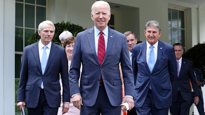 President Joe Biden, joined by a group of bipartisan Senators, walks to deliver remarks after the group of Senators reached a deal on an infrastructure package at the White House on June 24, 2021 in Washington, DC. (Kevin Dietsch/Getty Images)