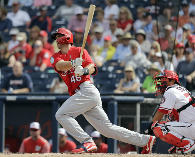 St. Louis Cardinals' Paul Goldschmidt follows through on a double during the fourth inning of an exhibition spring training baseball game against the Washington Nationals Tuesday, Feb. 26, 2019, in West Palm Beach, Fla. (AP Photo/Jeff Roberson)