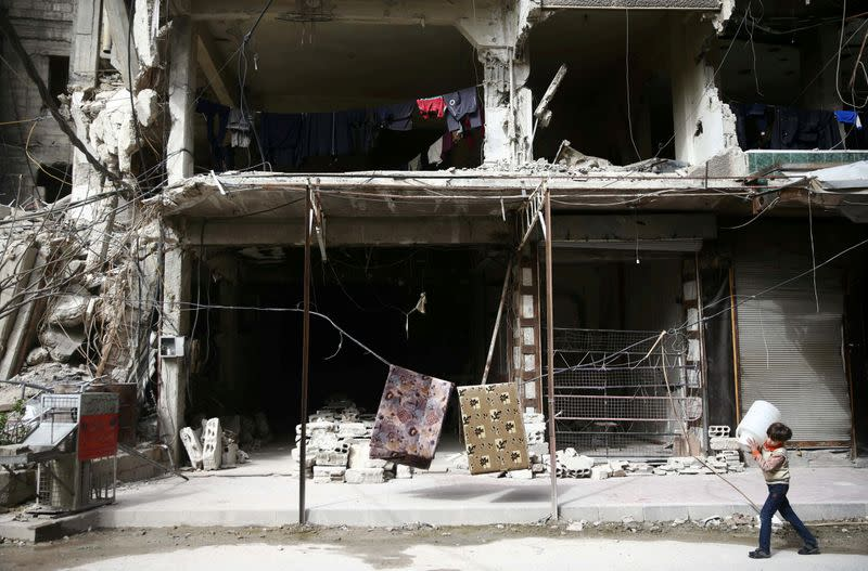 FILE PHOTO: A boy is seen in the besieged town of Douma, Eastern Ghouta, in Damascus