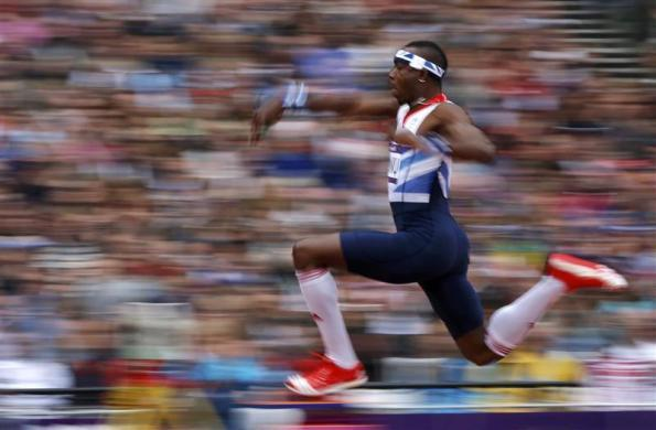 Britain's Phillips Idowu competes in the men's triple jump qualification during the London 2012 Olympic Games at the Olympic Stadium August 7, 2012.