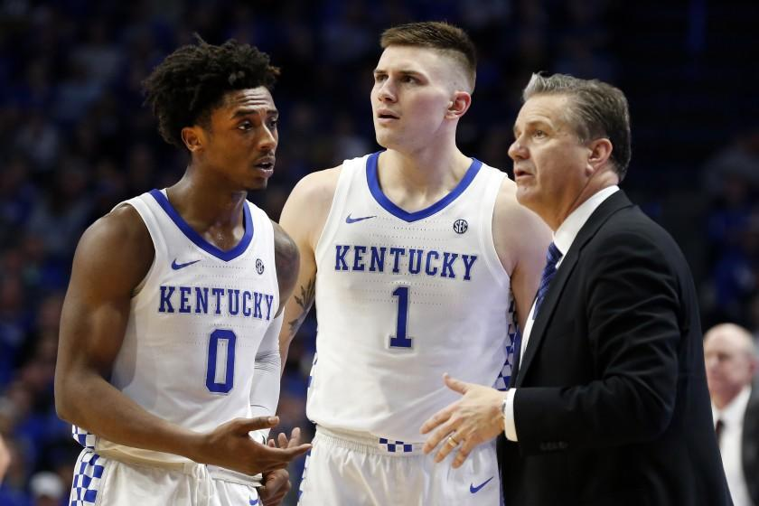 Kentucky's Ashton Hagans (0) and Nate Sestina (1) talk with coach John Calipari during the second half of the team's NCAA college basketball game against Mississippi State in Lexington, Ky., Tuesday, Feb. 4, 2020. Kentucky won 80-72. (AP Photo/James Crisp)