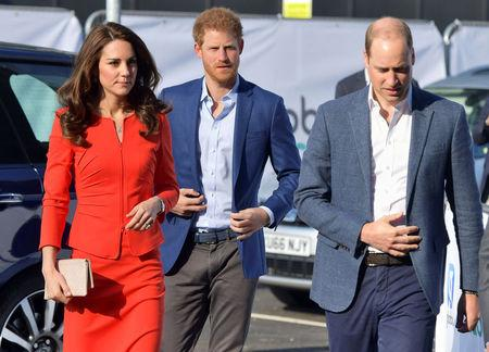 Britain's Prince William, Prince Harry and Catherine, the Duchess of Cambridge, arrive to open the Global Academy, a state school funded by a broadcasting group to train young people for careers in the media industry, in Hayes, near London