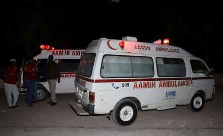 Aamin ambulances are seen after evacuating injured civilians from the scene of an explosion near the Presidential palace in Mogadishu, Somalia February 23, 2018. REUTERS/Feisal Omar