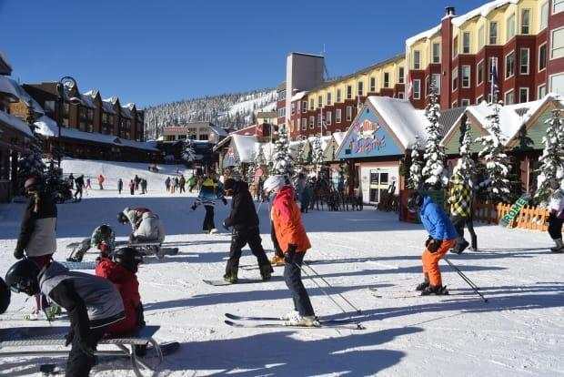 The village centre at Big White ski resort is pictured in 2017. The owner of a restaurant in the ski community near Kelowna, B.C., has apologized after the establishment hosted a rowdy party on Monday night. (Shutterstock / Tpt - image credit)