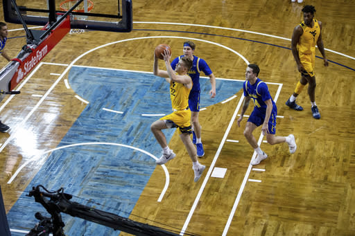 West Virginia guard (22) Sean McNeil drives for a layup past two South Dakota State defenders during an NCAA college basketball game Wednesday, Nov. 25, 2020, in Sioux Falls, S.D. (AP Photo/Josh Jurgens)