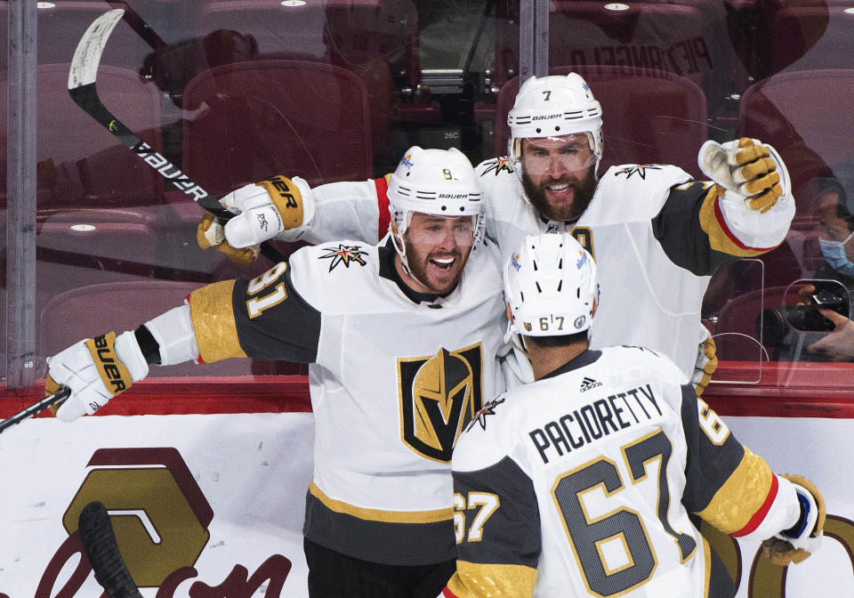 Vegas Golden Knights' Alex Pietrangelo (7) celebrates with Jonathan Marchessault (81) and Max Pacioretty after scoring against the Montreal Canadiensduring the third period of Game 3 of an NHL hockey semifinal series, Friday, June 18, 2021, in Montreal. (Graham Hughes/The Canadian Press via AP)