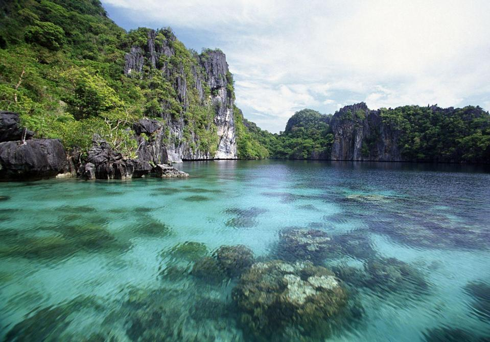 """<p>This now-iconic island in the Philippines is widely considered the world's best island, and for good reason. Besides the sugary white sands and crystal-clear waters, limestone rock formations, lush vegetation, hundreds of species of exotic birds, and an exciting culture make Palawan the ultimate destination for those seeking an exotic and tropical escape.</p><p><a href=""""https://mbcelnido.com/"""" rel=""""nofollow noopener"""" target=""""_blank"""" data-ylk=""""slk:Maremegmeg Beach Club"""" class=""""link rapid-noclick-resp"""">Maremegmeg Beach Club</a> opened in 2018 and has quickly become one of the most luxurious, sought-after stays in the area with immaculate sea views from every room and a fun, boutique-y vibe.</p>"""