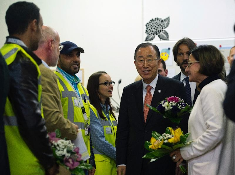 UN Secretary-General Ban Ki-moon (C), Austrian Interior Minister Johanna Mikl-Leitner (R) and Slovak Interior Minister Robert Kalinak visit asylum-seekers at a complex near the border with Hungary and Slovakia, October 19, 2015