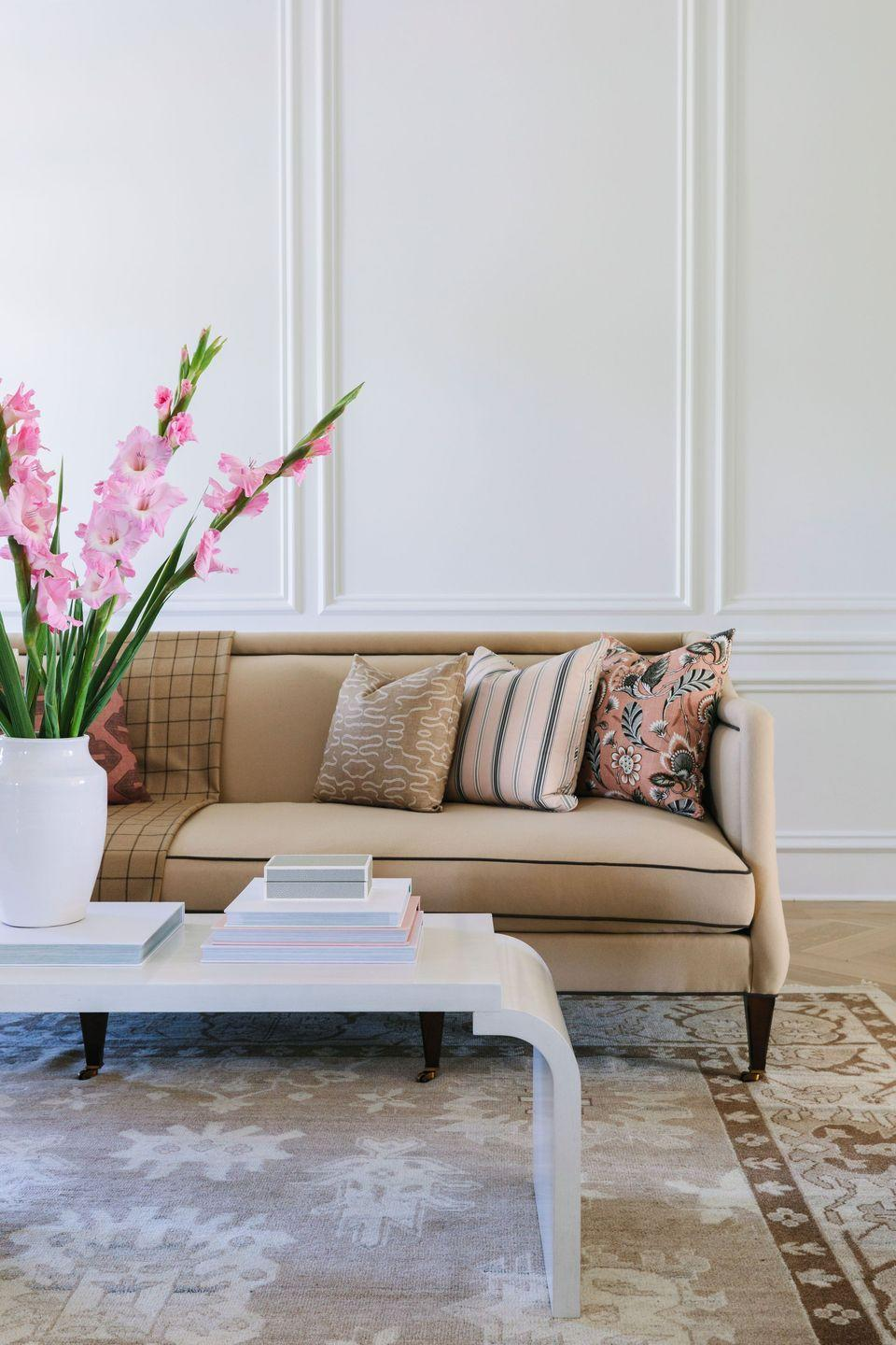 """<p>Ever since the """"millennial pink"""" craze began around 2016, blush has been a popular year-round color — but obviously, it's got a particular allure in spring. """"One of our favorite color combos for spring is white, camel/taupe, and soft pink,"""" says Bria Hammel of <a href=""""https://briahammelinteriors.com/"""" rel=""""nofollow noopener"""" target=""""_blank"""" data-ylk=""""slk:Bria Hammel Interiors"""" class=""""link rapid-noclick-resp"""">Bria Hammel Interiors</a>. """"It's such a timeless color palette because of its neutrality, but it also provides a bit of warmth and subtle color to a space without going too over the top."""" </p><p><strong>RELATED:</strong> <a href=""""https://www.goodhousekeeping.com/home/decorating-ideas/g1500/decor-ideas-living-room/"""" rel=""""nofollow noopener"""" target=""""_blank"""" data-ylk=""""slk:50+ Living Room Ideas for an Inspired Space"""" class=""""link rapid-noclick-resp"""">50+ Living Room Ideas for an Inspired Space</a></p>"""