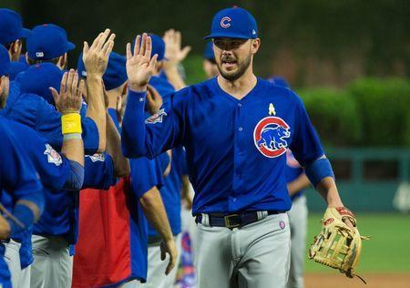 FILE PHOTO: Sep 1, 2018; Philadelphia, PA, USA; Chicago Cubs third baseman Kris Bryant (17) celebrates with team mates after a victory against the Philadelphia Phillies at Citizens Bank Park. Mandatory Credit: Bill Streicher-USA TODAY Sports/File Photo