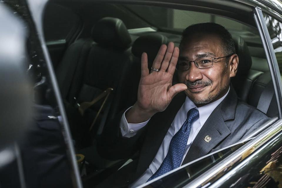 Foreign Minister Datuk Seri Hishammuddin Hussein waves at the press as he arrives at the Prime Minister's Office in Putrajaya October 23, 2020. — Picture by Hari Anggara